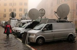 Satellite news gathering   and Outside Broadcast (OB) vans at an event